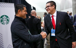 Adalbert Aisporo, 20, shakes hands with Starbucks Regional Vice President Miguel Lozano after Aisporo was offered at job at the Los Angeles Opportunity Youth Hiring Fair at the LA Convention Center. Thousands of young people came to the fair searching for a job. The coalition of companies and service agencies offered a range of help to the young people. Photographed on Feb 11, 2016. (Joshua Trujillo, Starbucks)
