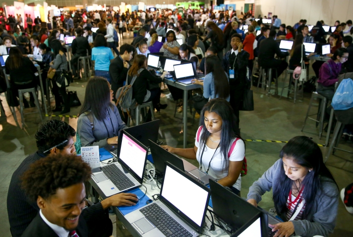 Young people apply for jobs at the Los Angeles Opportunity Youth Hiring Fair at the LA Convention Center. Thousands of young people came to the fair searching for a job. The coalition of companies and service agencies offered a range of help to the young people. Photographed on Feb 11, 2016. (Joshua Trujillo, Starbucks)