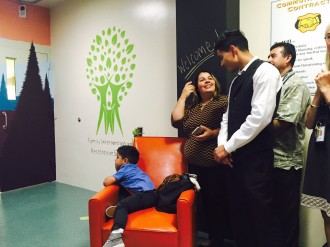 Sergio Vera, 17, celebrates the opening of the FIRS Center with his family. He believes it will improve support and access to services for many youth like himself.