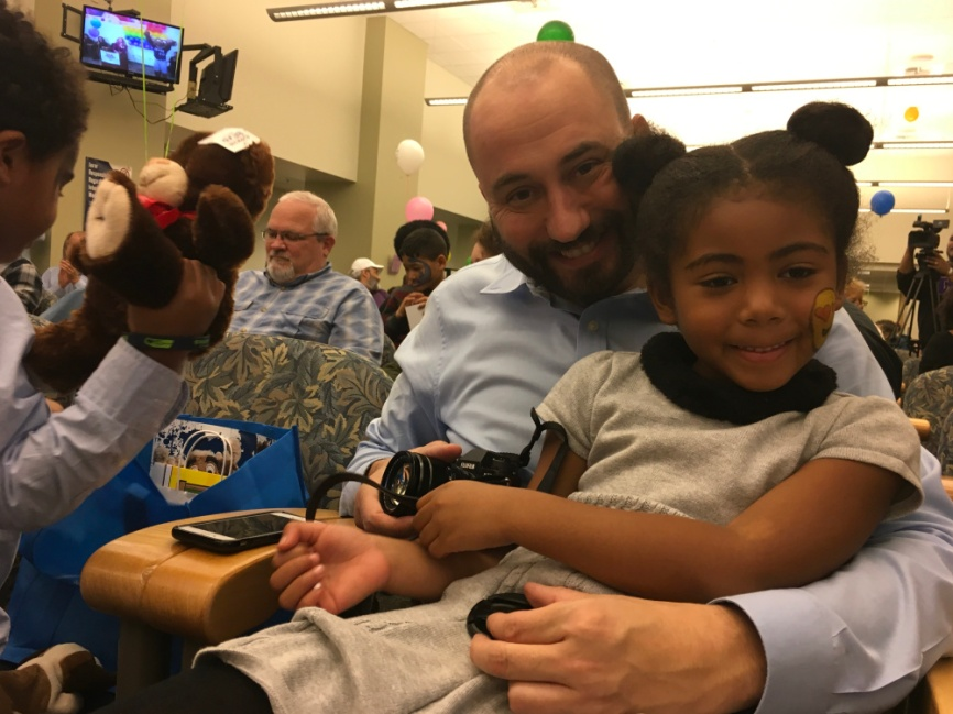 Image of a dad and daughter at the National Adoption Month celebration